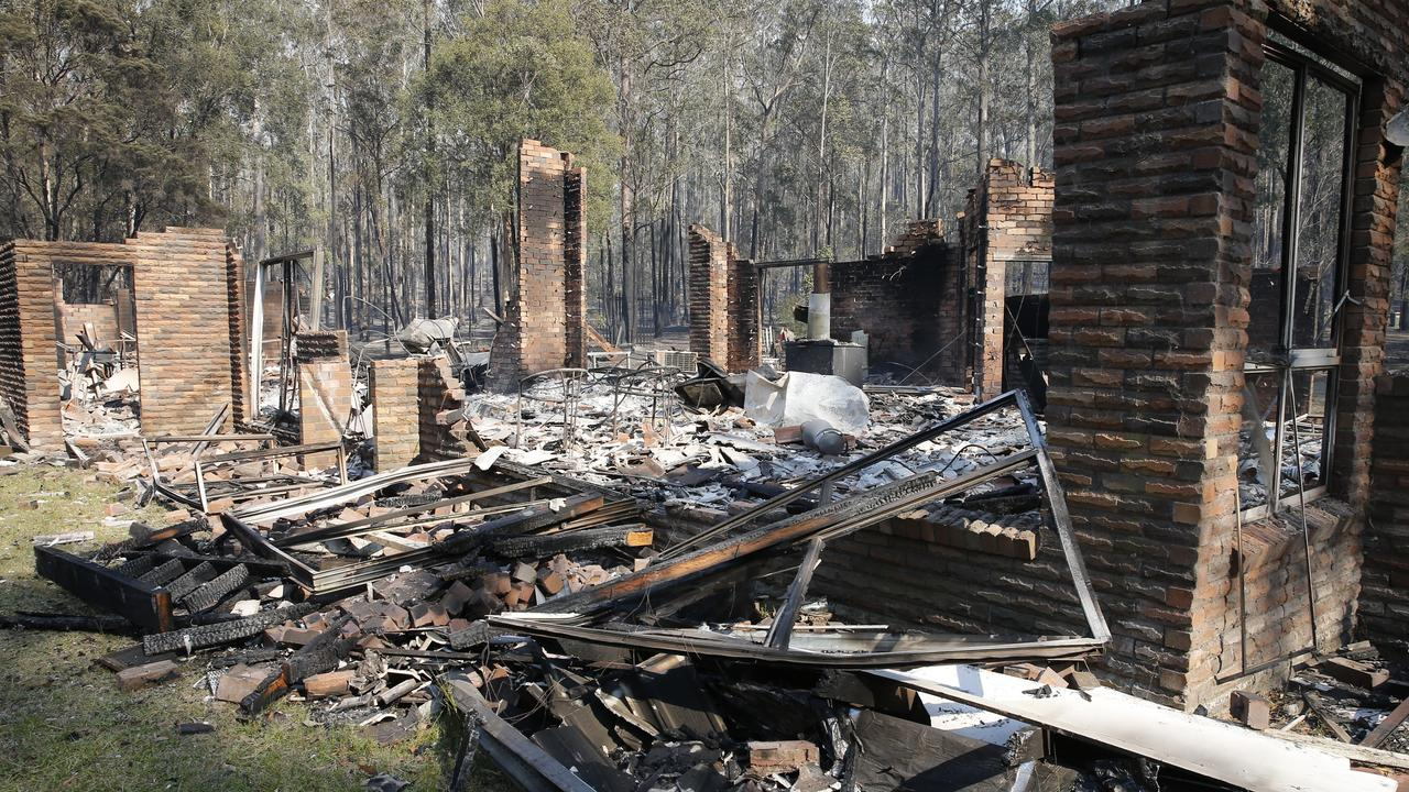 The remains of the residence at Four Paws boarding kennels smoulders along the Pacific Highway south of Taree. Picture: AAP Image/Darren Pateman