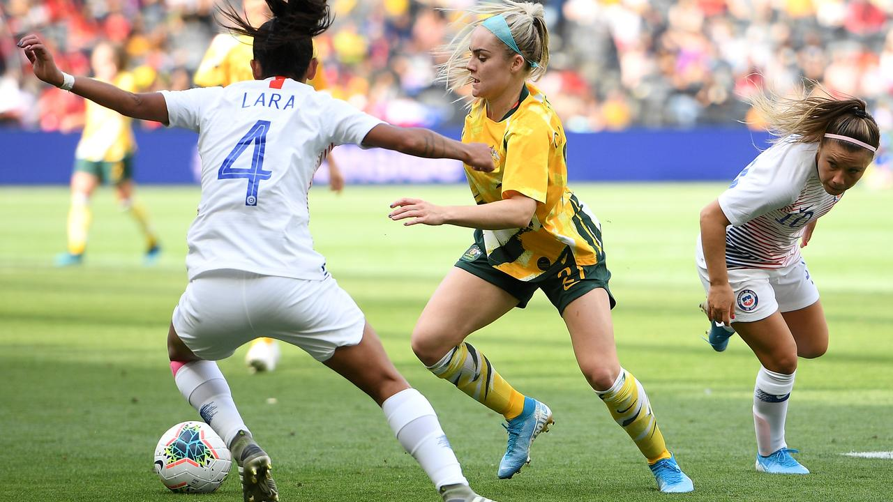 Australia's Ellie Carpenter takes on Chile's Francisca Lara. Picture: AAP
