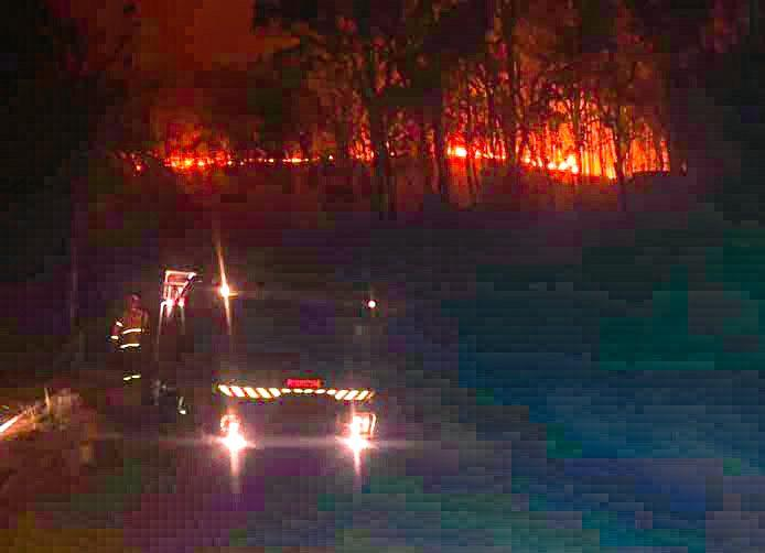 Firefighters fight the blaze that destroyed much of the village of Wytaliba