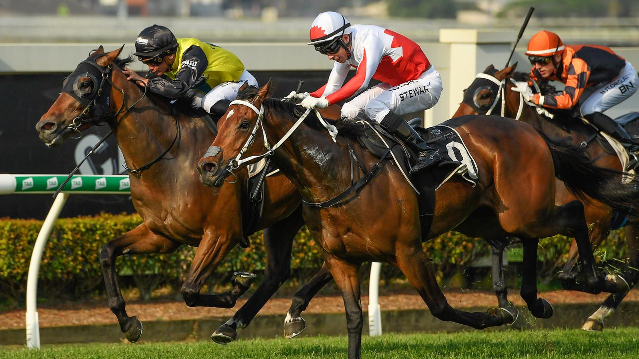 Jockey Ron Stewart rides Trevelyan (centre) to victory. Picture: AAP Image/Albert Perez