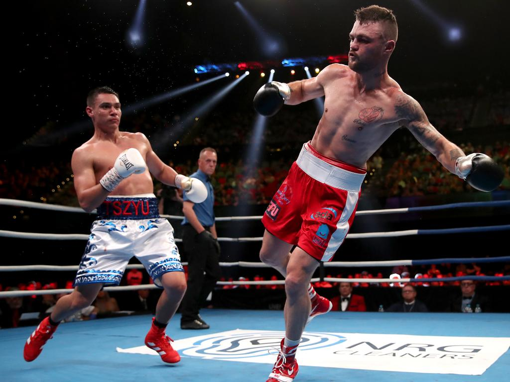 Dwight Ritchie (R) reels away from a punch by Tim Tszyu during their WBO Global and IBF Australasian super welterweight title fight. Picture: Cameron Spencer/Getty Images