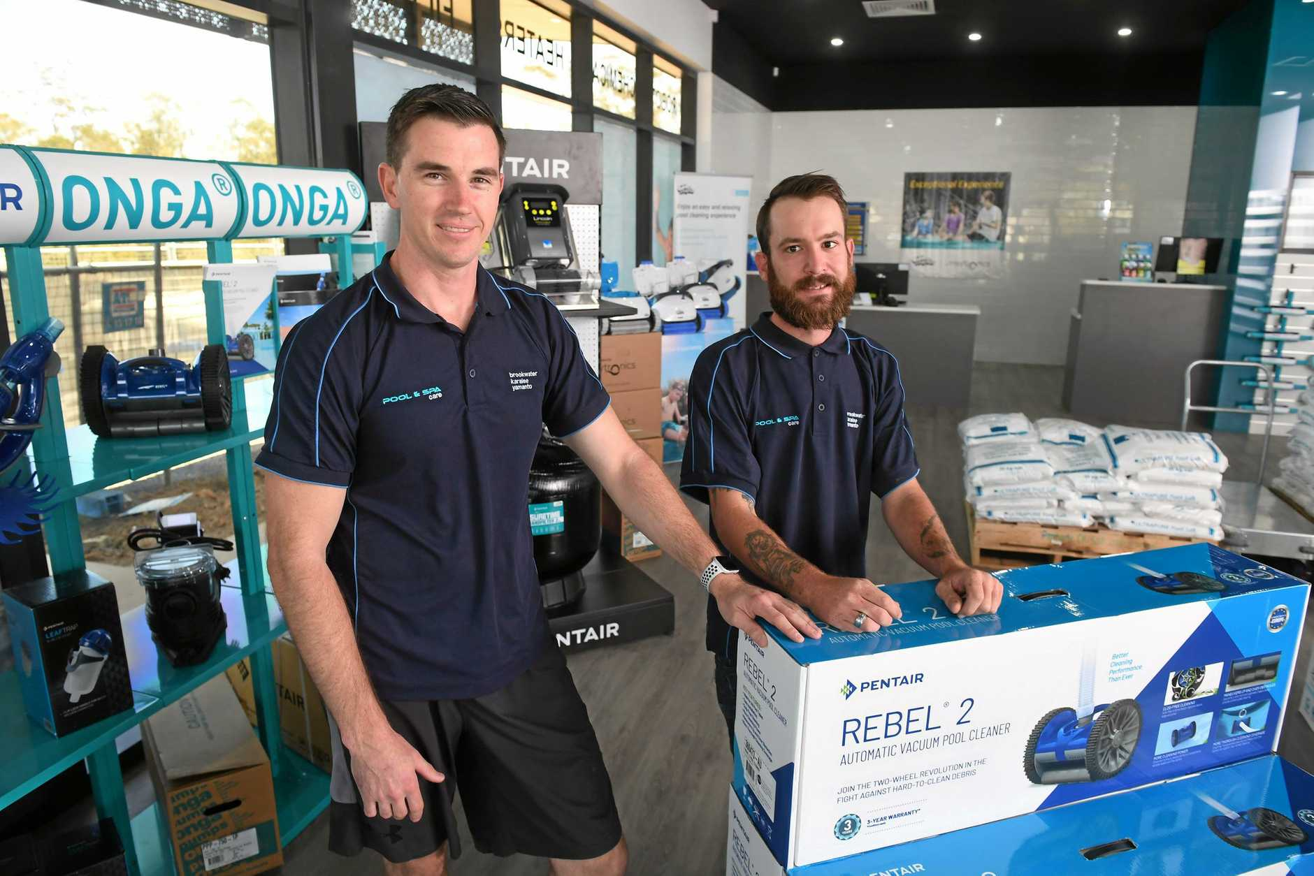 NEW ADDITION: Pool and Spa Care Karalee manager Shaun Baker and service technician Jesse Melvin.