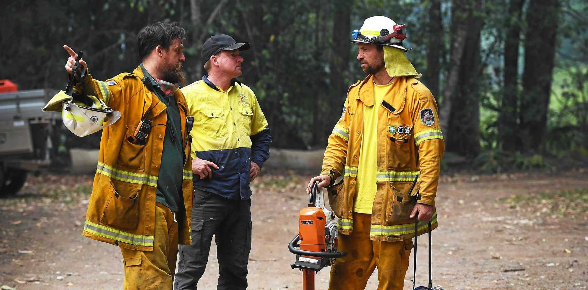 Rural Fire Service discuss ongoing fire preparations and fire fighting efforts near Tuntable Falls as emegency service personal prepare for a horror day with high winds.