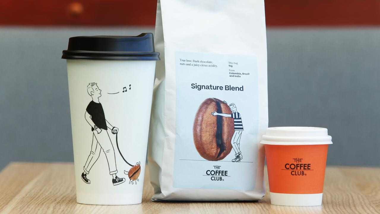 Recyclable coffee cups and examples of The Coffee Club rebranding. A new logo will be revealed early next year. Picture: AAP Claudia Baxter