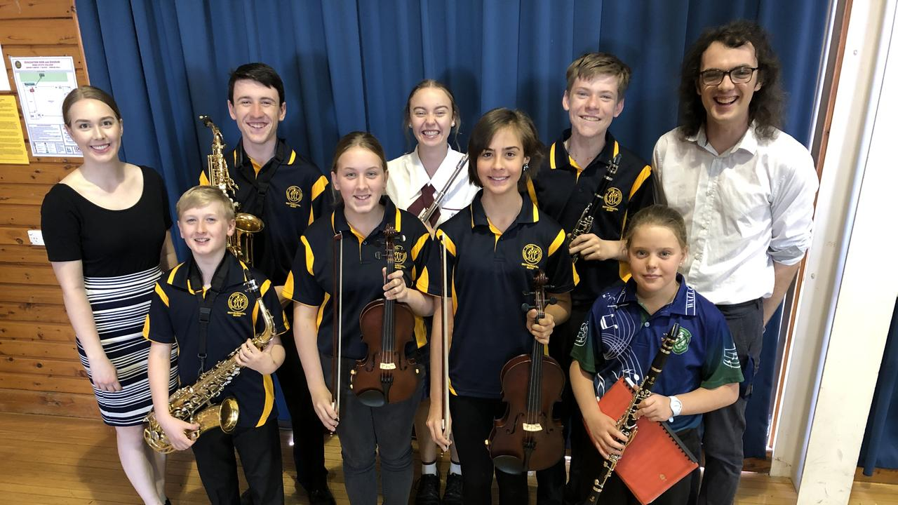 TUNED IN: Instrumental music teachers Sam Barnes (left) and Sam Muller (right) with some of their students from Roma State College, Wallumbilla State School and St John's School