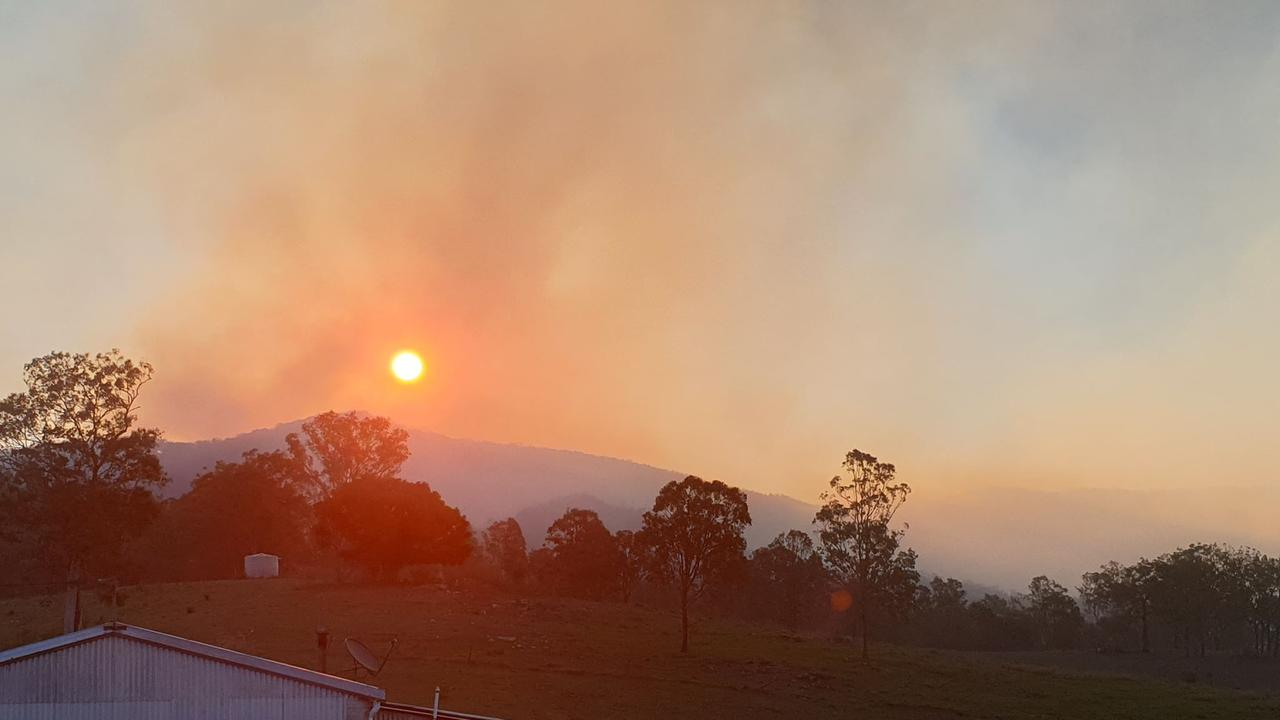 The fire front rages on the top of Black Snake Range on Sunday evening. Photo taken from Thorneside Rd, Widgee.