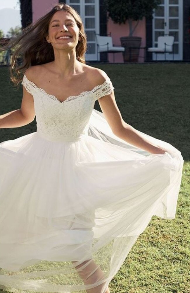 The discount wedding dress (pictured) the woman had selected wasn't a hit with her friends.