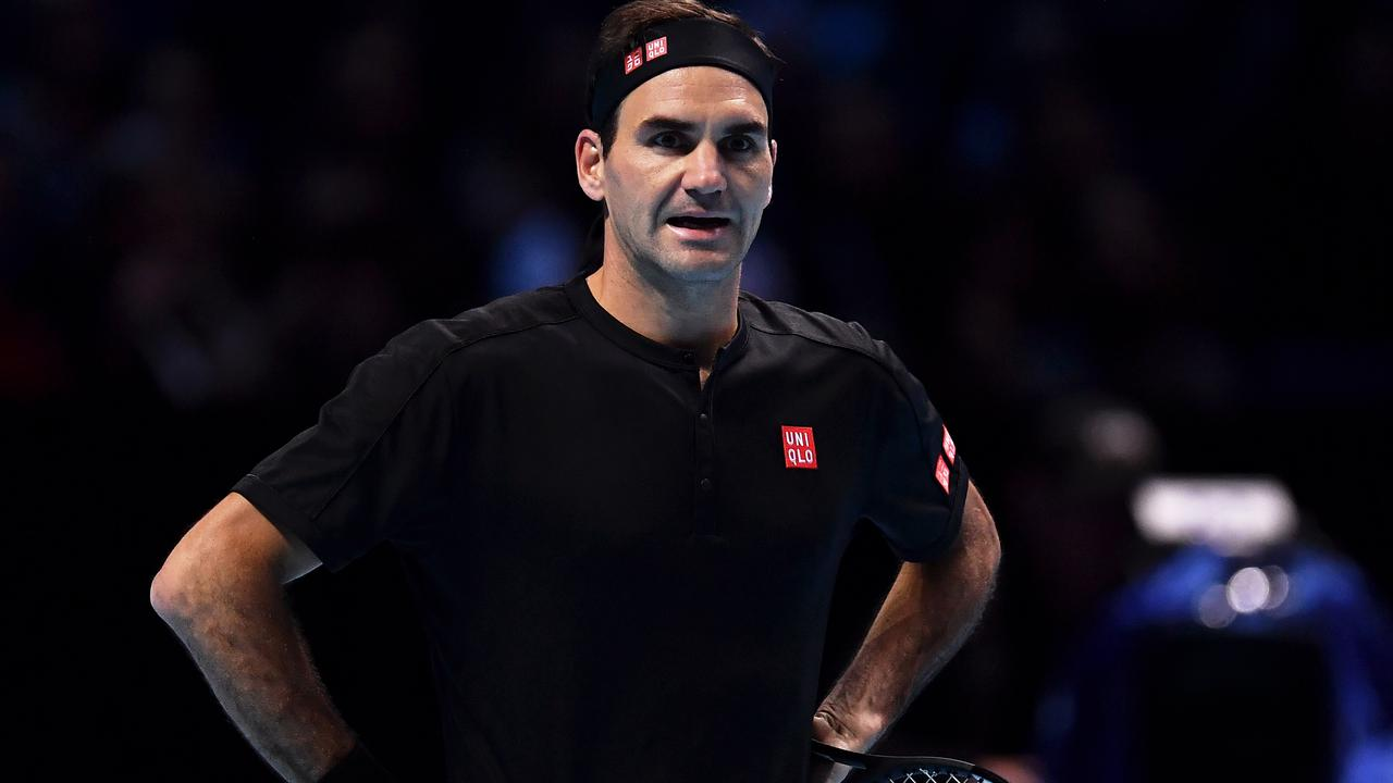 LONDON, ENGLAND - NOVEMBER 10: Roger Federer of Switzerland reacts as he questions a line call in his singles match against Dominic Thiem of Austria during Day One of the Nitto ATP World Tour Finals at The O2 Arena on November 10, 2019 in London, England. (Photo by Justin Setterfield/Getty Images)