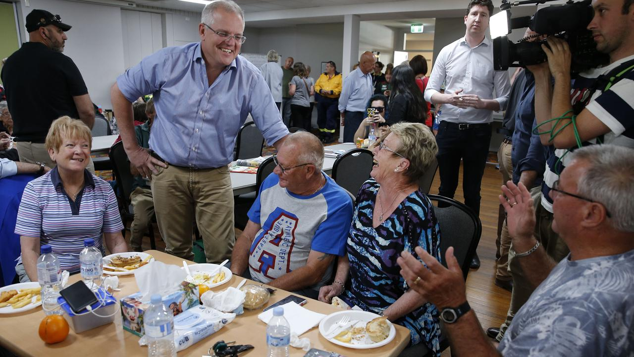 Mr Morrison talks to locals during a visit to Club Taree Evacuation Centre. Picture: AAP Image/Darren Pateman