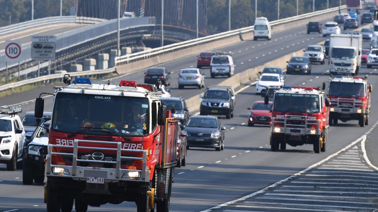 A convoy of Country Fire Authority trucks from Victoria make their way north along the M1 towards the Central Coast north of Sydney. Picture: AAP