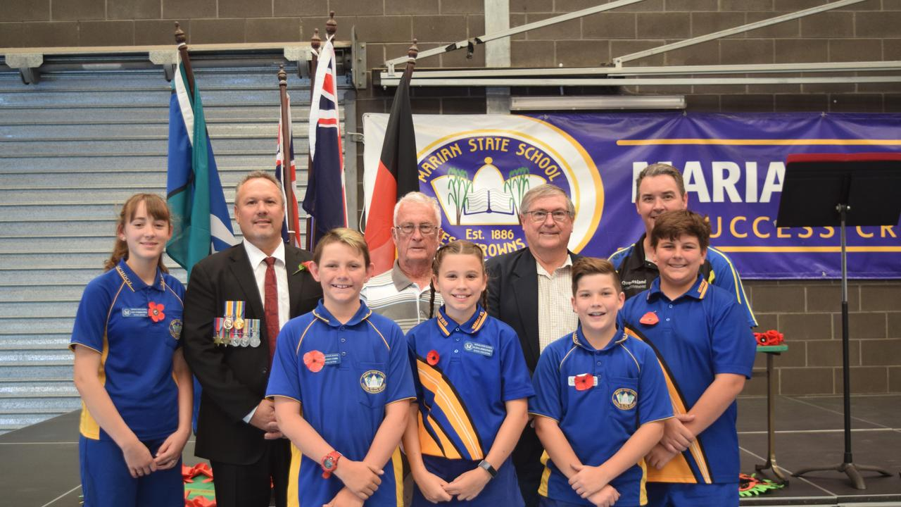 L-R: (back)Lilly Forrester, Mirani MP Stephen Andrew, Bernard Feeney, Bob Murry, Principal Len Fehlhaber; (front) Jackson Cork, Elissa Jorgenson, Wyatt Schmidke and Connor Germanotta presented the Remembrance Day ceremony at Marian State School for 2019.