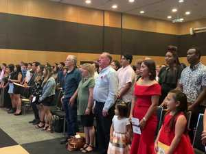 New Australian citizens sing the anthem for the first time