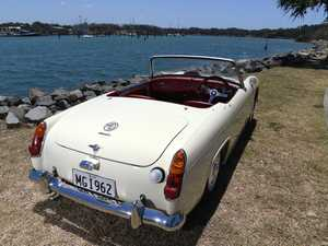 Carole Cooke with the 1962 MG Midget