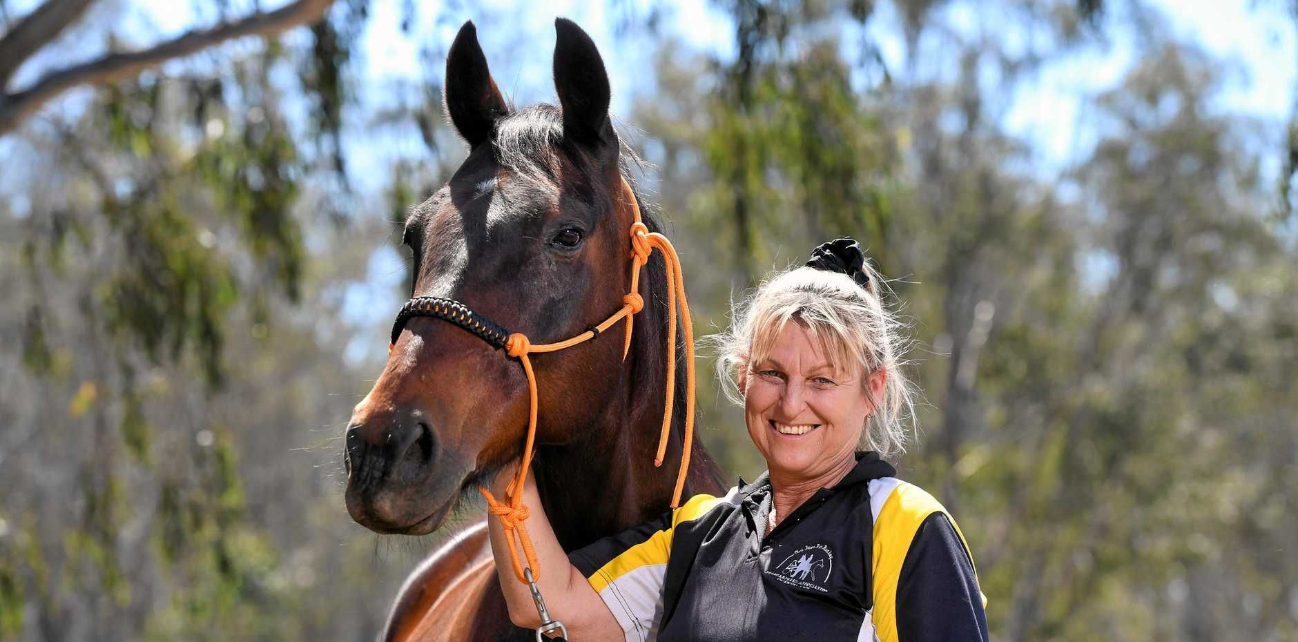 BRIGHTER FUTURE: Melissa Bellfrom Standardbred Association of Queensland with 12-year-old former harness racing Standardbred, Boots.