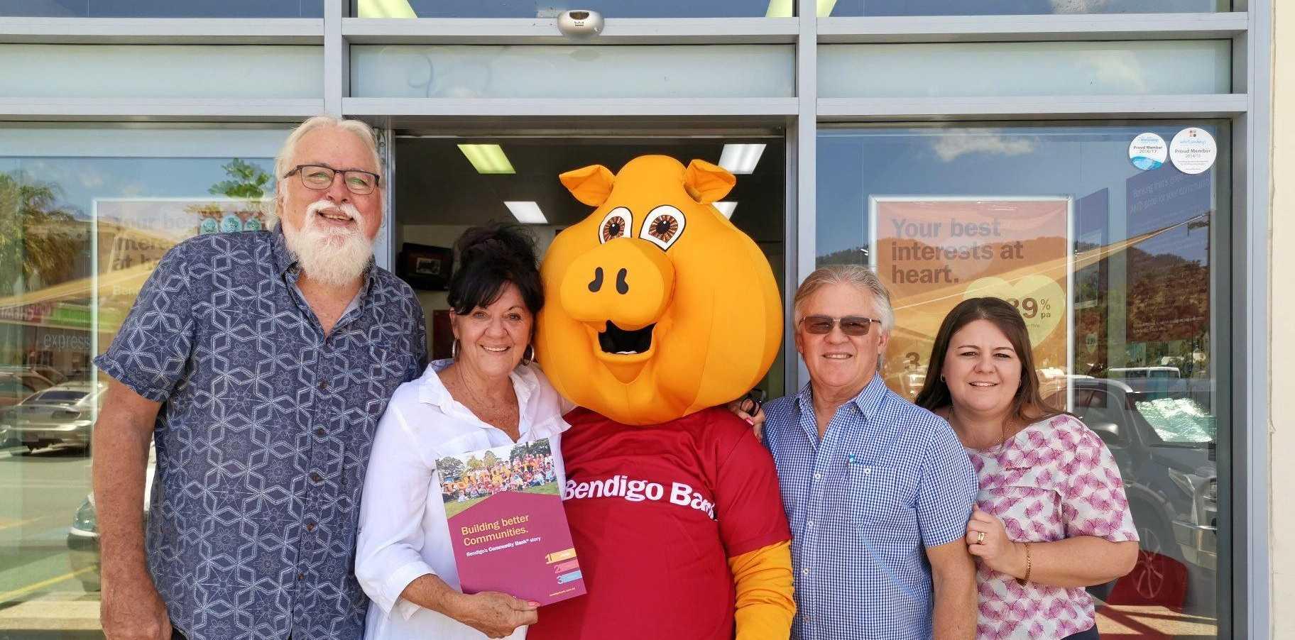Whitsundays Arts Festival committee (from left) treasurer Tom Casey, president Cathy Knezevic with sponsor Bendigo Bank's mascot, Bendigo Bank chairman Mark Henry and branch manager Tiff Deakes.