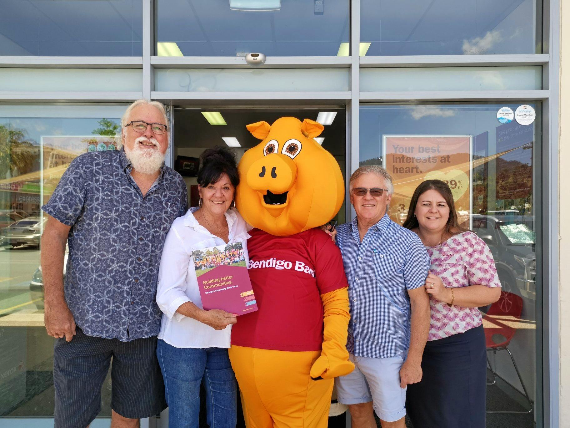 Whitsundays Arts Festival committee (from left) treasurer Tom Casey, president Cathy Knezevic with sponsor Bendigo Bank's mascot, Bendigo Bank chairman Mark Henry and branch manager Tiff Deakes.