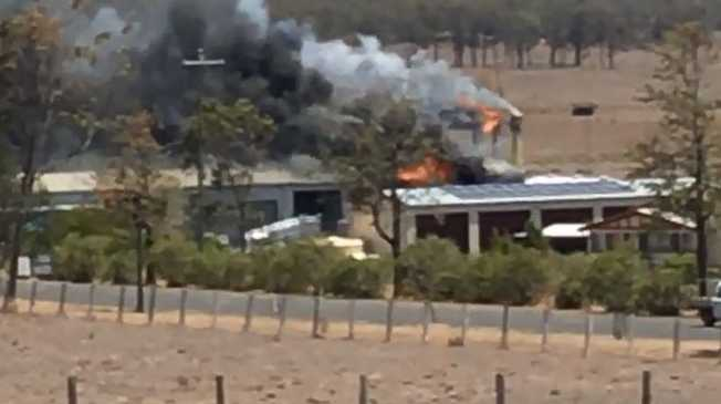 VIDEO: Explosions rock Goombungee as a business burns