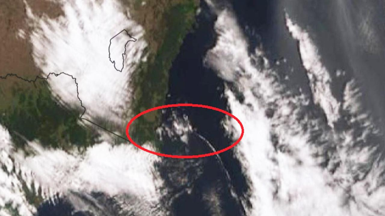The southerly buster can bee seen in this satellite image as a thin white line of cloud stretching from the coast of southern NSW heading north. It brings with it a huge change in wind direction, the most dangerous time for bushfires to flare up. Picture: BOM.
