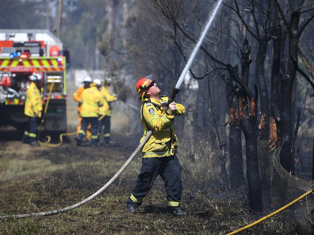 Crew mop up after a grass fire impacted a property on Fourth Ave, Llandilo. Picture: Dan Himbrechts