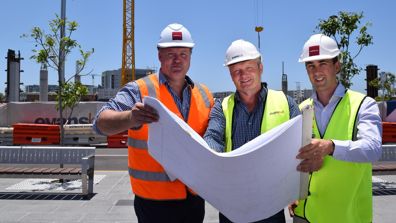 PLANS: Foundation Place in the Maroochydore CBD is celebrating a significant milestone with the first crane being erected on site in the CBD today. Pictured is Evans Long director Matthew Evans, Dave Pateman of Evans Built and Duncan Craighead of Evans Long. Photo: Eden Boyd
