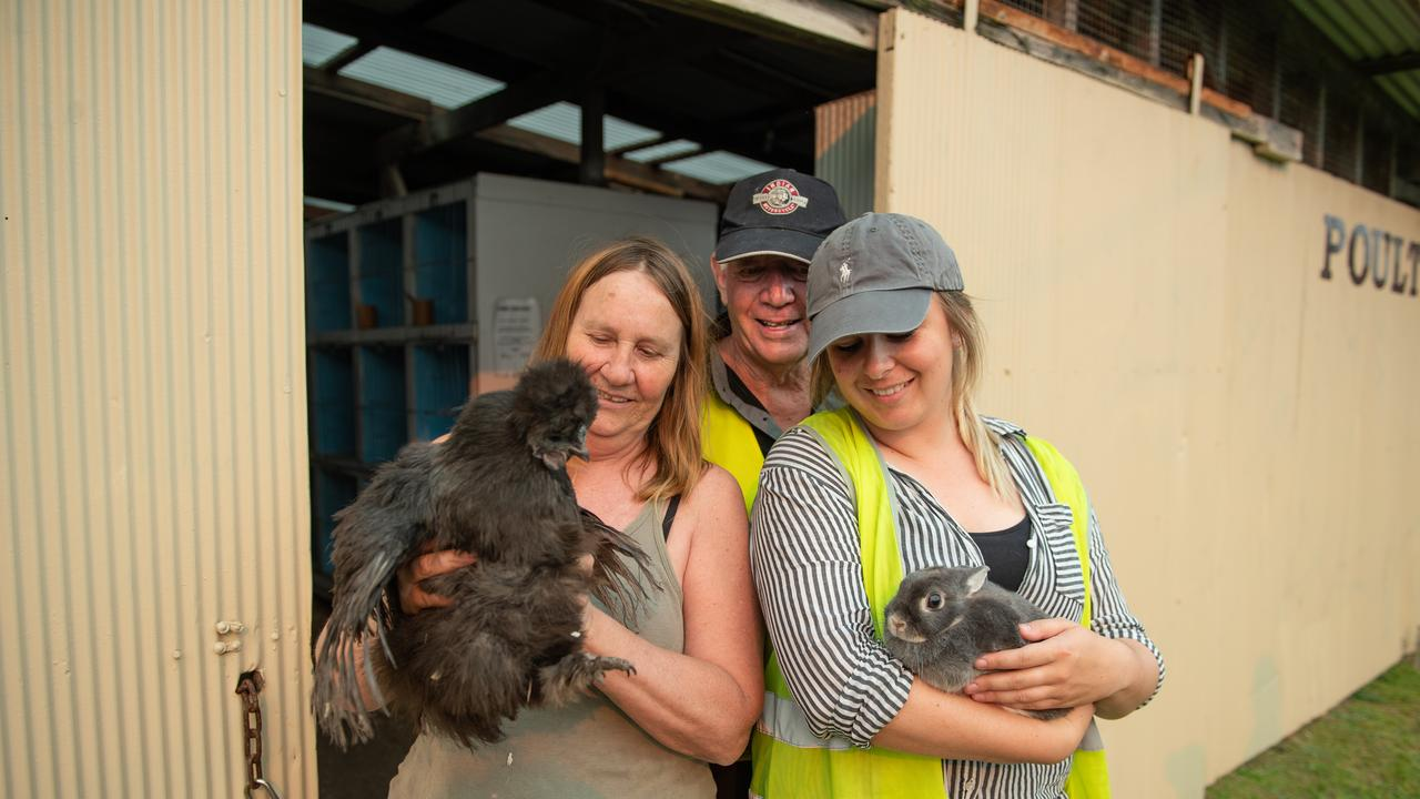 """Marie, Chris and Taylor with a couple of new temporary """"residents"""" at the Coffs Harbour Showground."""