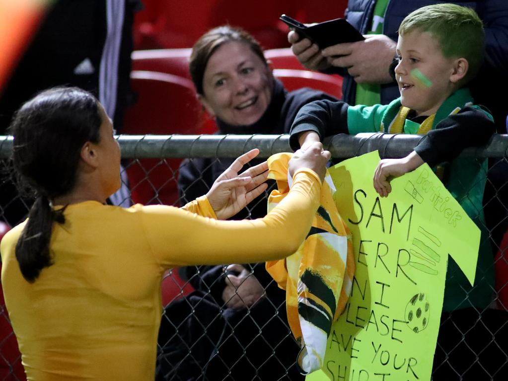 Matildas captain Sam Kerr gives her shirt to a young fan after the match. Picture: AAP