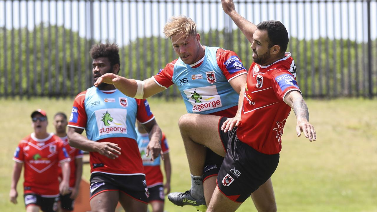 Jack de Belin and Josh Kerr collide at the Dragons' pre-season training in Wollongong. Picture: Dylan Robinson.