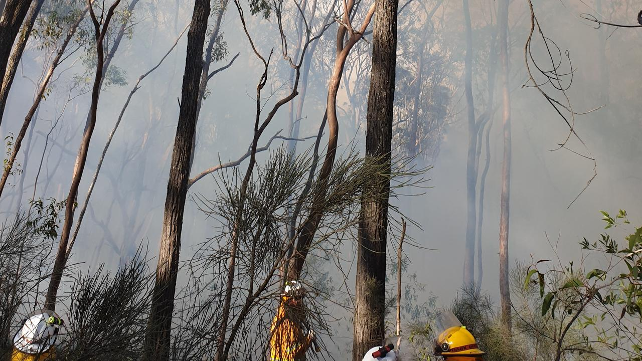 Firefighters fight in tough conditions at Black Snake on Sunday as bushfire burns in rugged country.