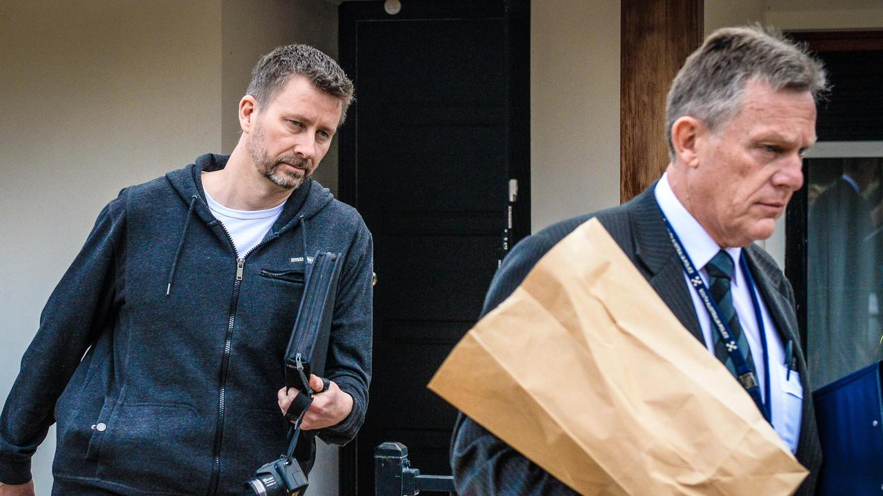 Detectives at an Andrews Farm property during the investigation into the murder of Mark Boyce in 2017. Picture: AAP / Roy Vandervegt
