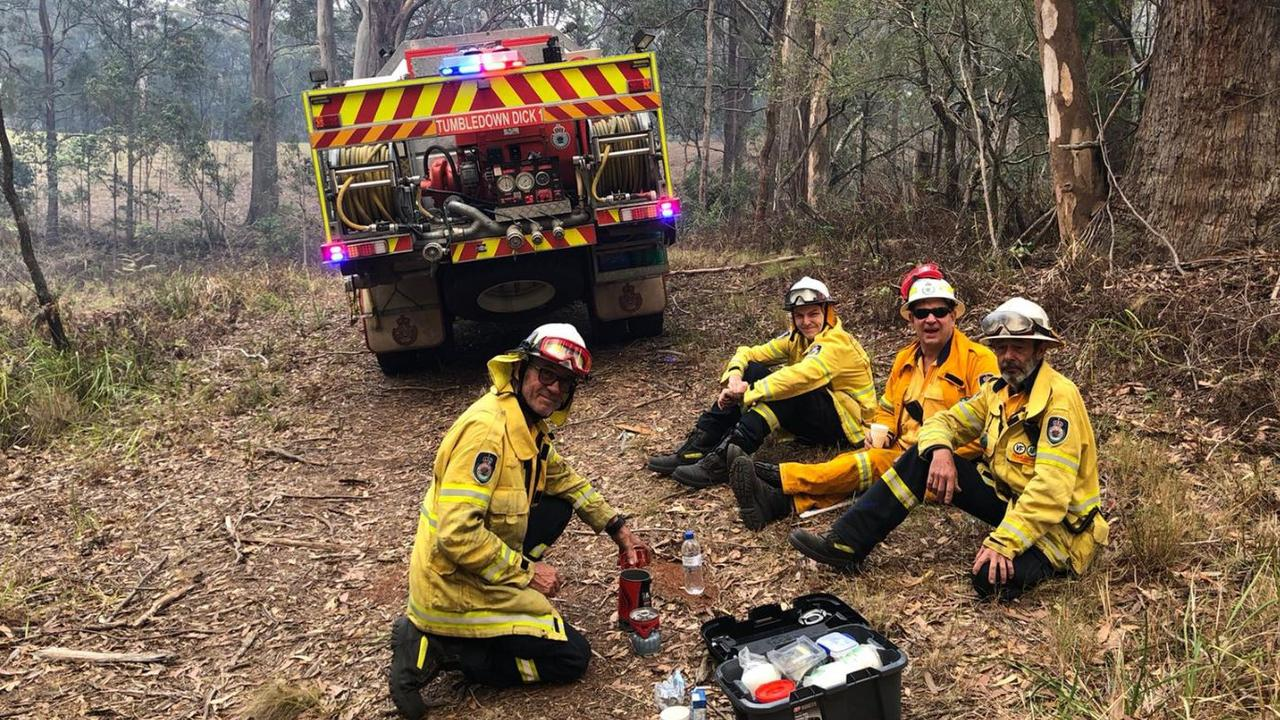 Firefighters take a break after battling blazes at Port Macquarie. Picture: Tumbledown Dick Captain John Watson.