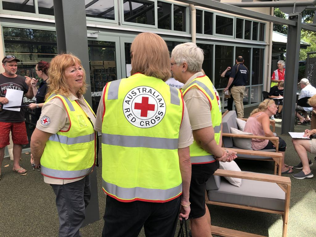 Red Cross volunteers at the Community Recovery Hub, set up to assist people suffering hardship because of bush fires and forced evacuation.
