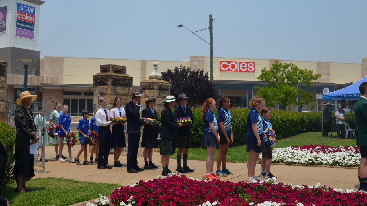 WREATH LAYING: Students of Warwick's schools lay wreaths at the Remembrance Day Service.