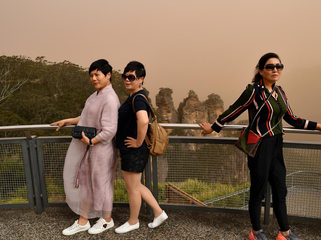Tourists seen at the Three Sisters lookout in Katoomba in Sydney. Picture: AAP Image/Joel Carrett