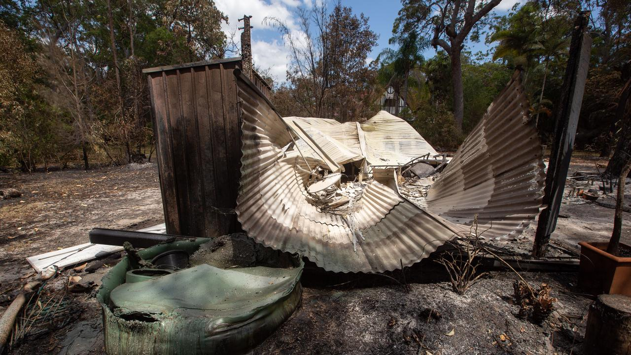 A burnt-out car, cabin and sheds owned by resident Thorsten Kels at Lake Cooroibah Road, Noosa, Monday, November 11, 2019. Thousands of residents have been evacuated over the weekend due to fires, the most on Saturday from a huge fire at Cooroibah, north of Noosa. (AAP Image/Rob Maccoll) NO ARCHIVING