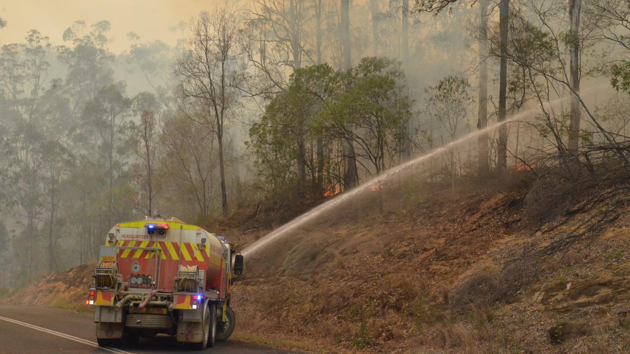 Fire crews battle blazes in and around Nymboida, south of Grafton, NSW on November 9. Hundreds of people were affected and many lost their homes and animals.
