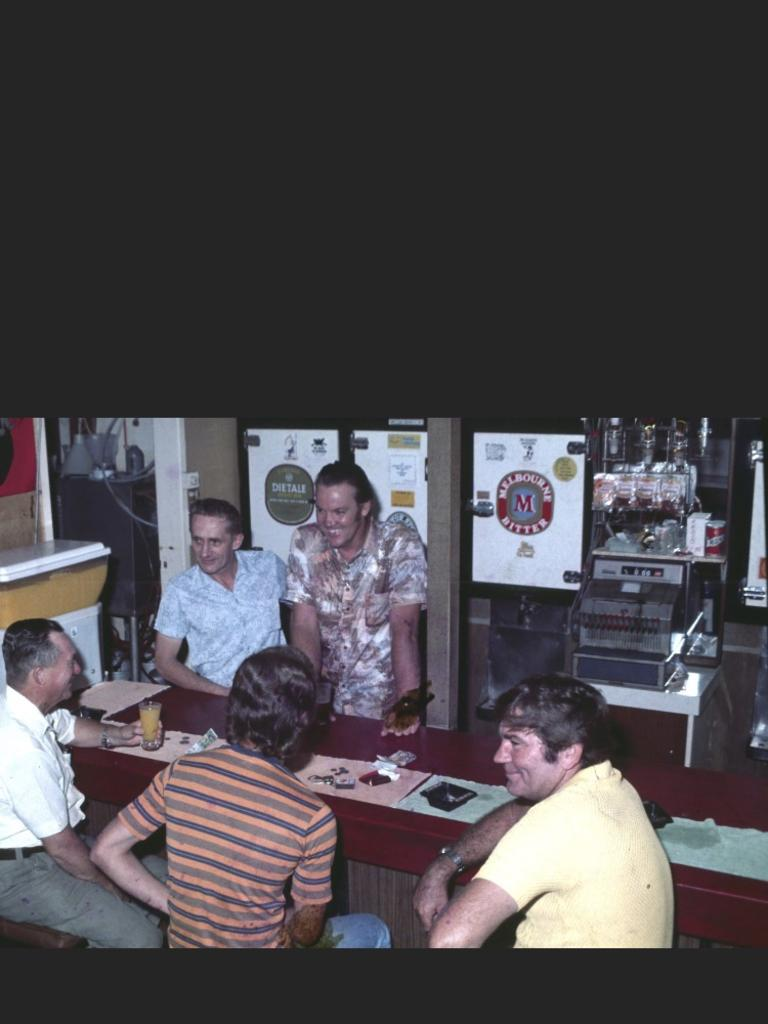 CHEERS DON: Don Jacobsen (leaning on the bar top right) was a proactive manager of the Commercial Hotel with a great sense of humour.