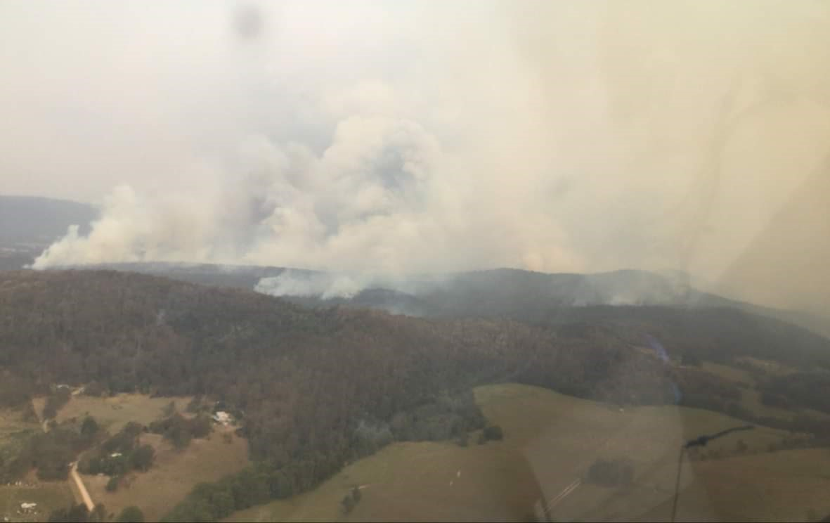 The Liberation Trail Fire burning towards Nana Glen from the air.