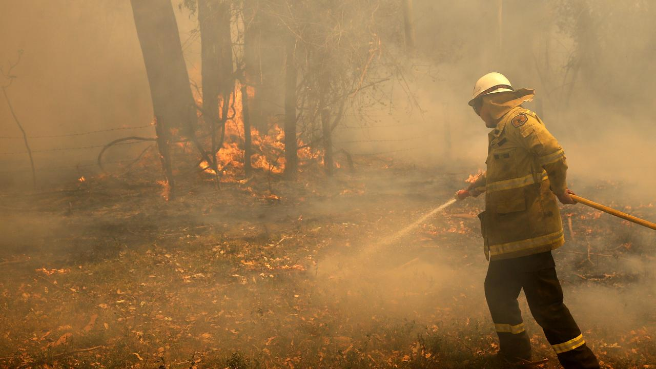 A National Parks crewman fights a blaze at Koorainghat, part of the Hillville fire near Taree, in the Mid North Coast region of NSW, Tuesday, November 12, 2019. Parts of NSW face catastrophic bushfire danger on Tuesday, with residents in bushland areas told to leave early rather than wait for fresh fires to start. (AAP Image/Darren Pateman) NO ARCHIVING