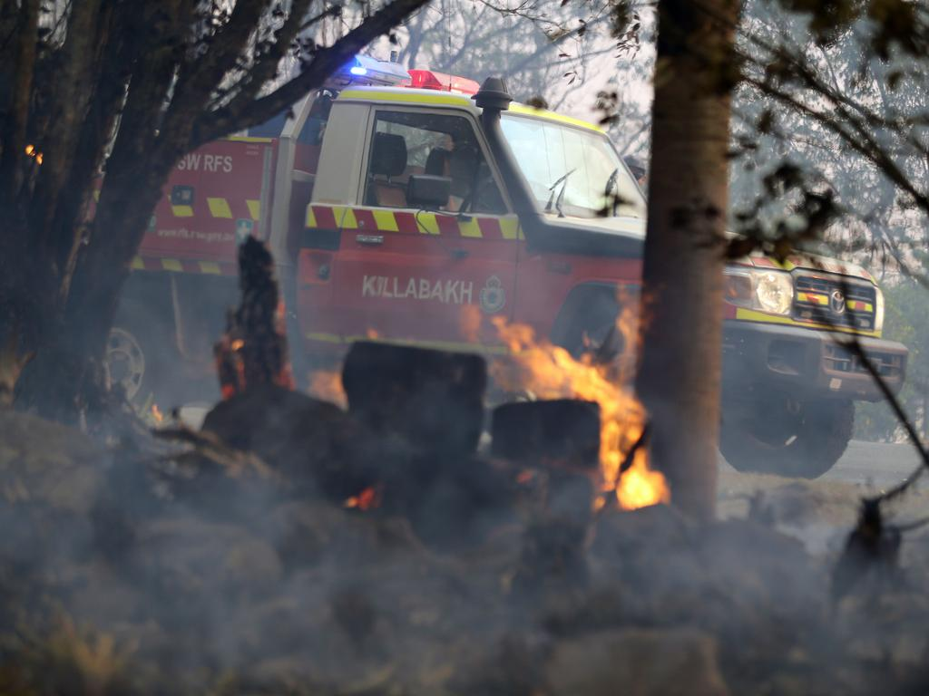 Locals and RFS volunteers battle to save homes in and around the village of Killabakh. Picture: Gary Ramage