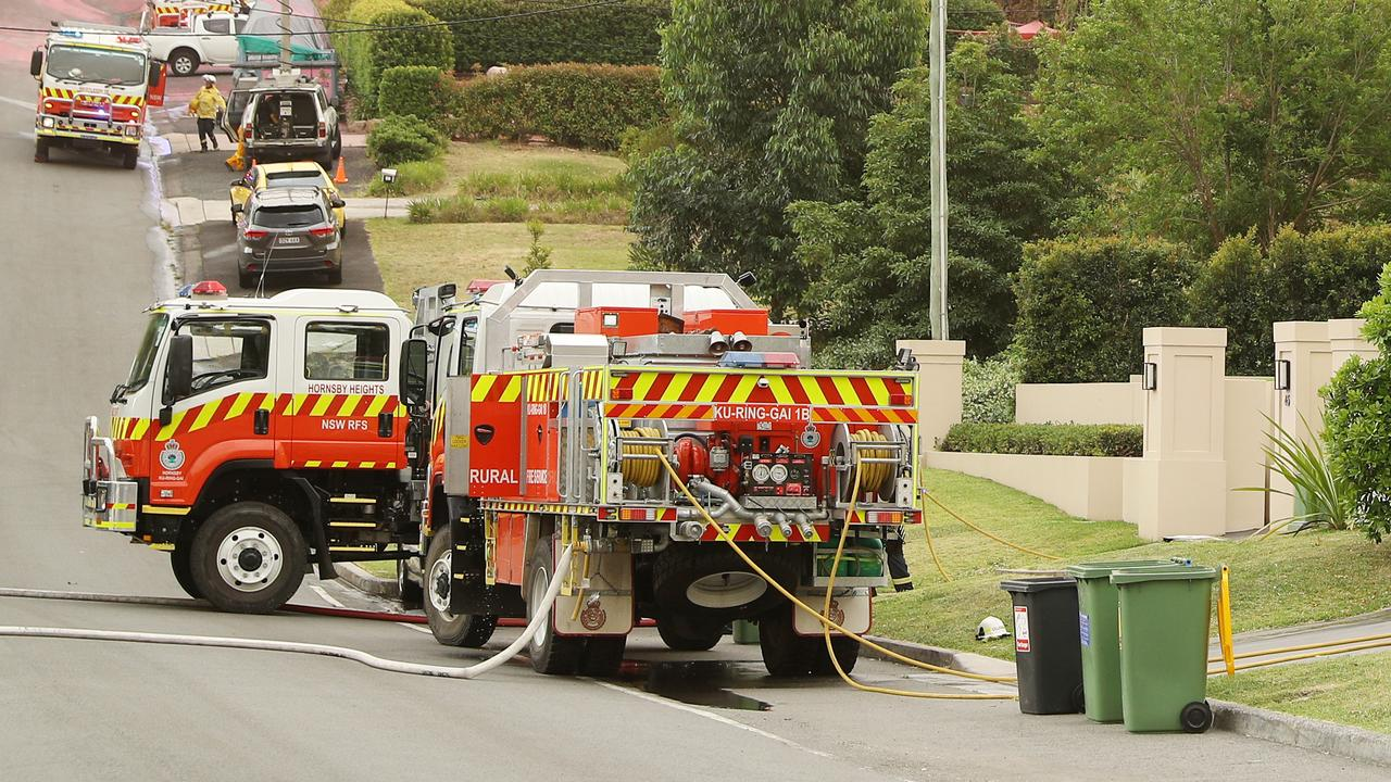 Firefighters respond yesterday to a fire at South Turramurra, which is suspected by being lit by an arsonist. Picture: Matrix