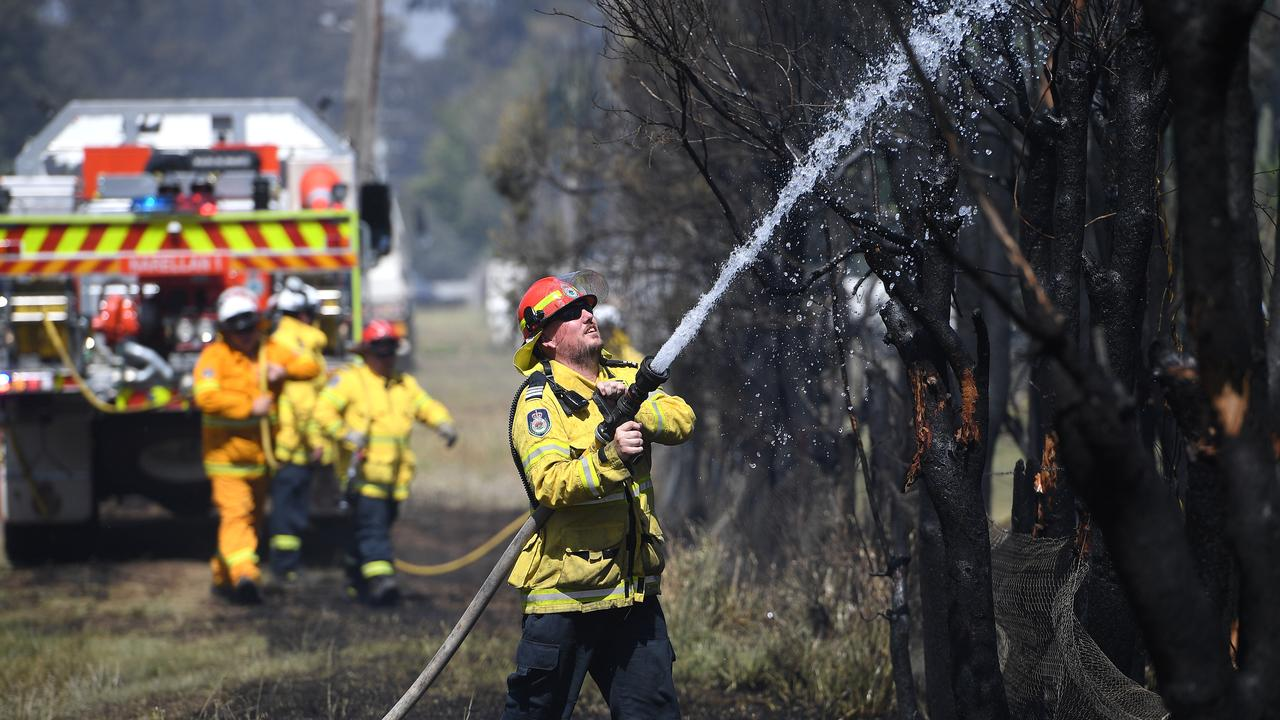 NSW Rural Fire Service crews mop up after a grass fire impacted a property on Fourth Avenue, Llandilo, west of Sydney, Tuesday, November 12, 2019. Parts of NSW face catastrophic bushfire danger on Tuesday, with residents in bushland areas told to leave early rather than wait for fresh fires to start. (AAP Image/Dan Himbrechts) NO ARCHIVING