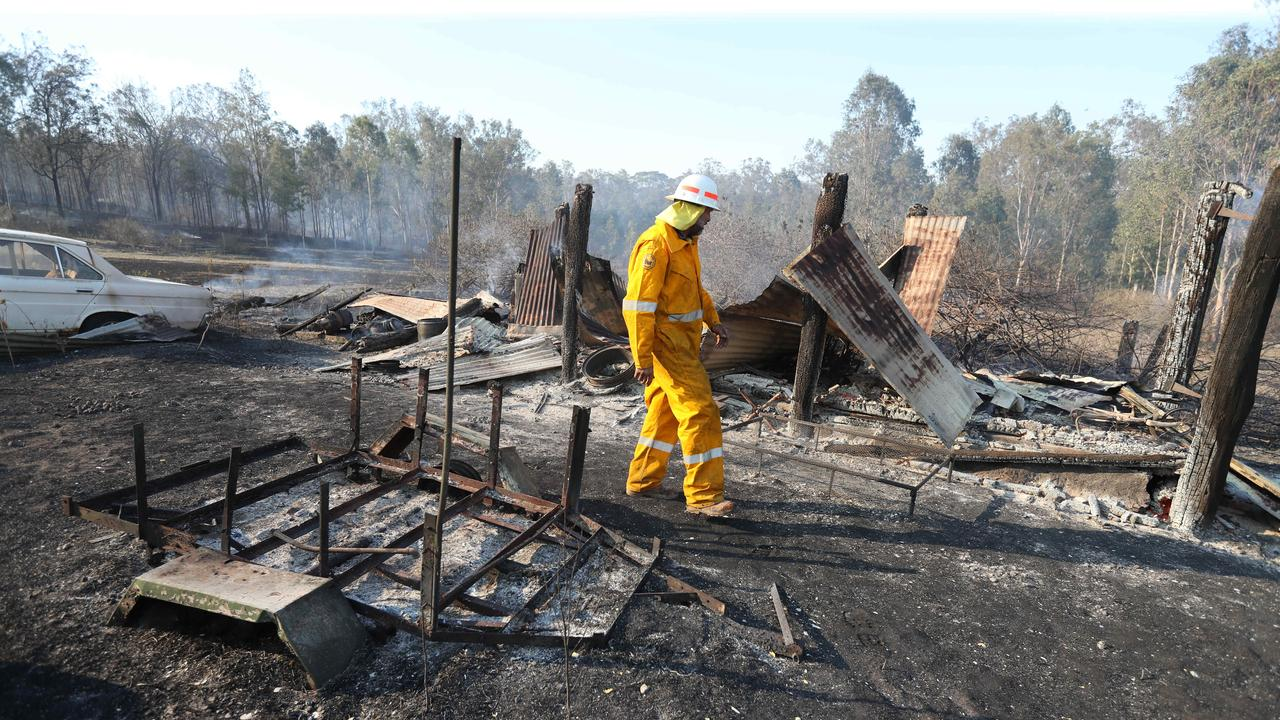 DESTRUCTION: Brett Nagel from the Rural Fire Brigade surveys damage on Spicers Gap Rd. Picture: Annette Dew.