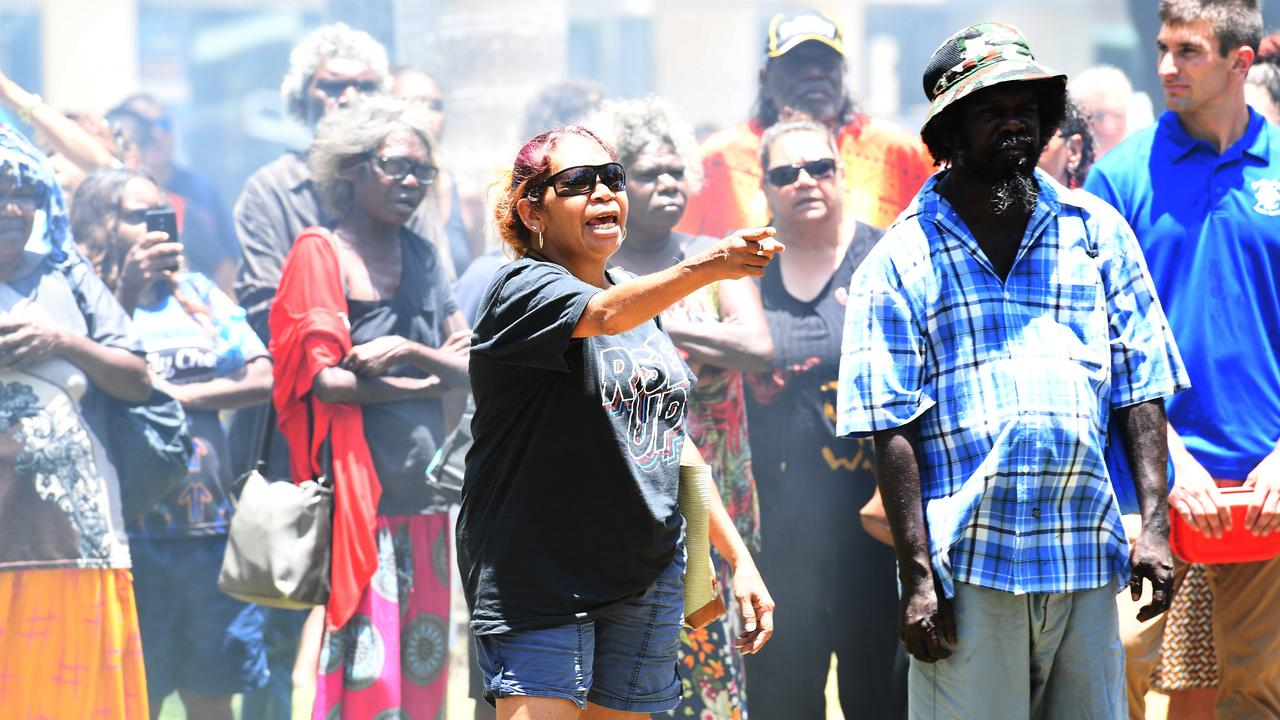 A protester shares her thoughts with the protest crowd at Darwin's Parliament House. Picture: Katrina Bridgeford