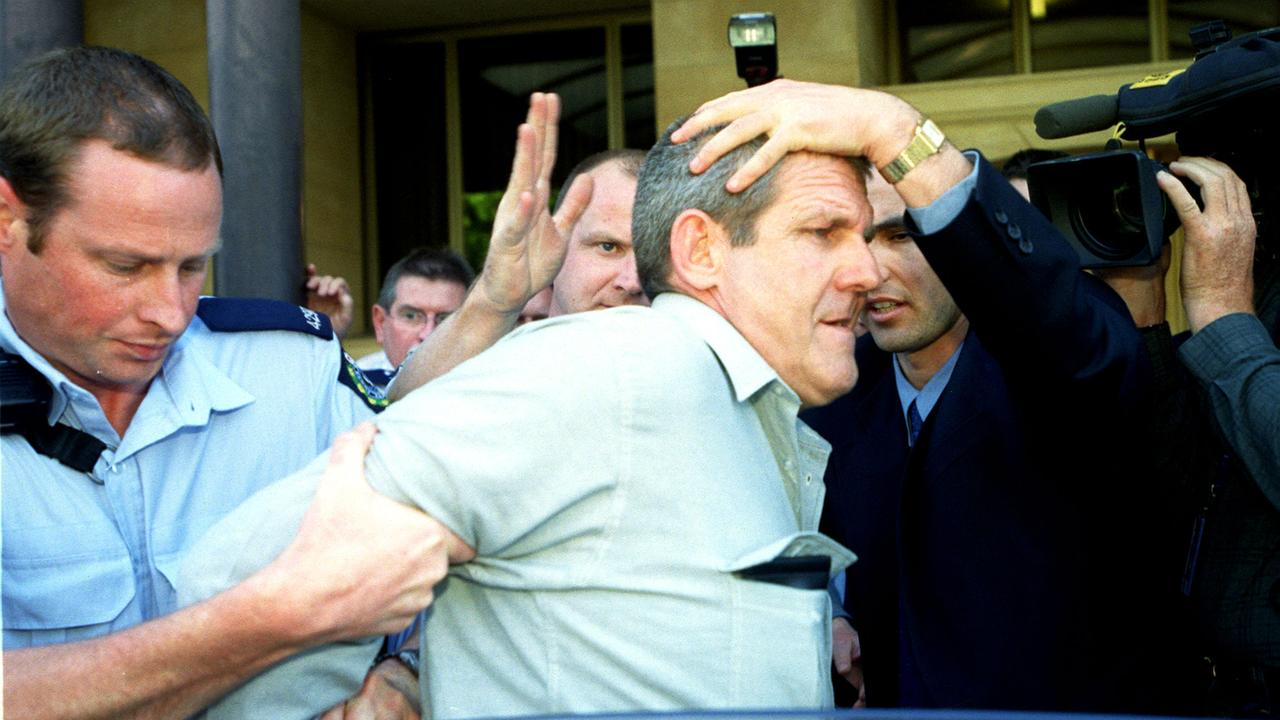 On November 10, 2003, Bradley John Murdoch was handcuffed and placed in the back of a vehicle by police. He was later charged with the murder of British backpacker Peter Falconio. Picture: Michael Milnes