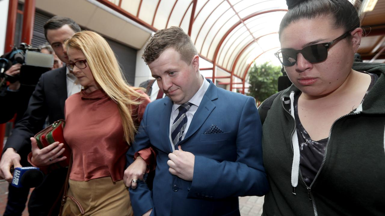 William Russell, centre, leaves the Adelaide District Court in October with supporters after an earlier court appearance. Picture: AAP / Kelly Barnes