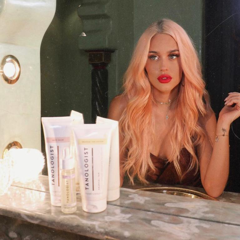Lottie Tomlinson is the mastermind behind tanning brand Tanologist that's just launched in Australia. Picture: Instagram / Lottie Tomlinson