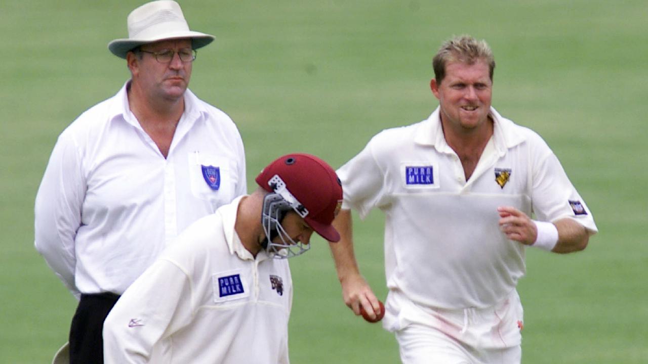 Victoria's David Saker runs past umpire Darrell Hair and Queensland batsman Stuart Law during the 2000 Sheffield Shield final.