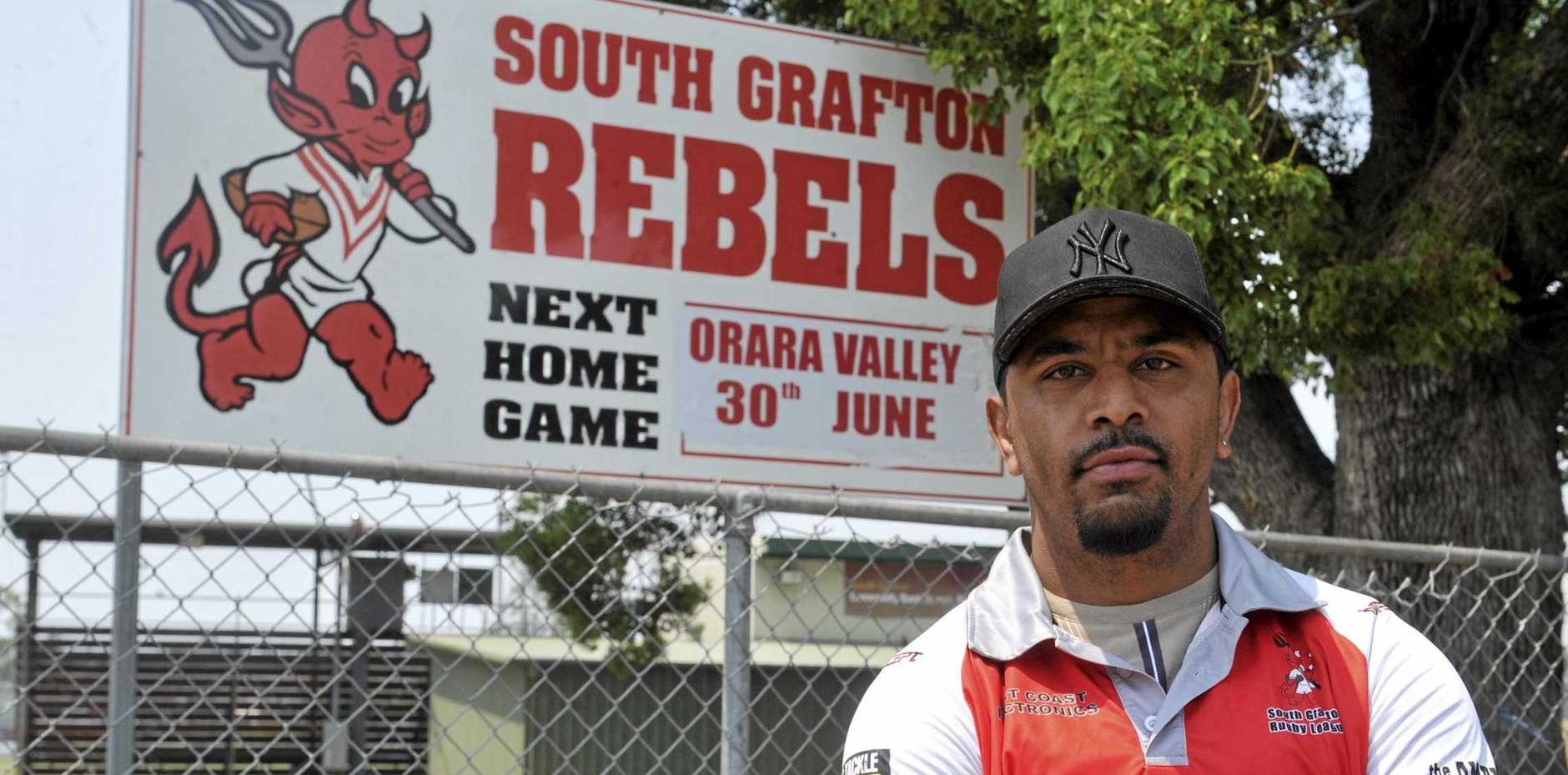 South Grafton Rebels new coach Roy Bell in front of the Rebels sign at McKittrick Park.