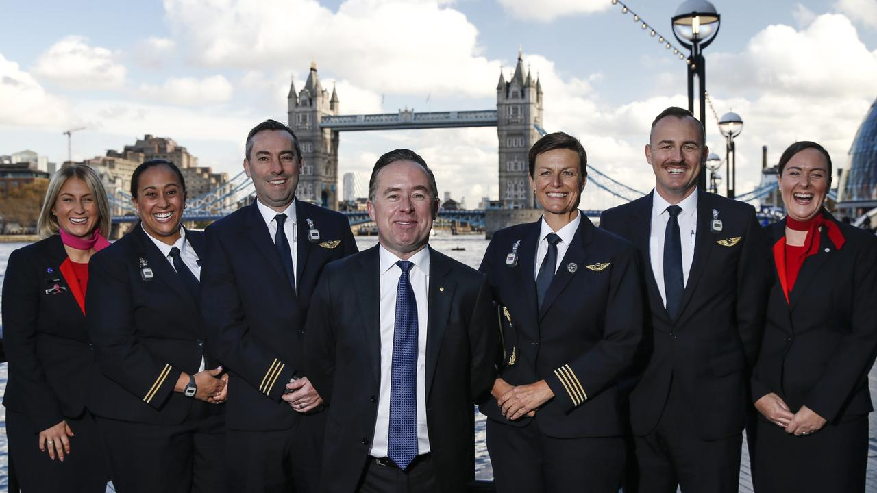 Qantas CEO Alan Joyce (C) with cabin crew (L-R) Sophie Singleton, Teagan Gray, Ryan Gill, Captain Helen Trenerry, Chris Agnew and Lucy Houston. Picture: Hollie Adams