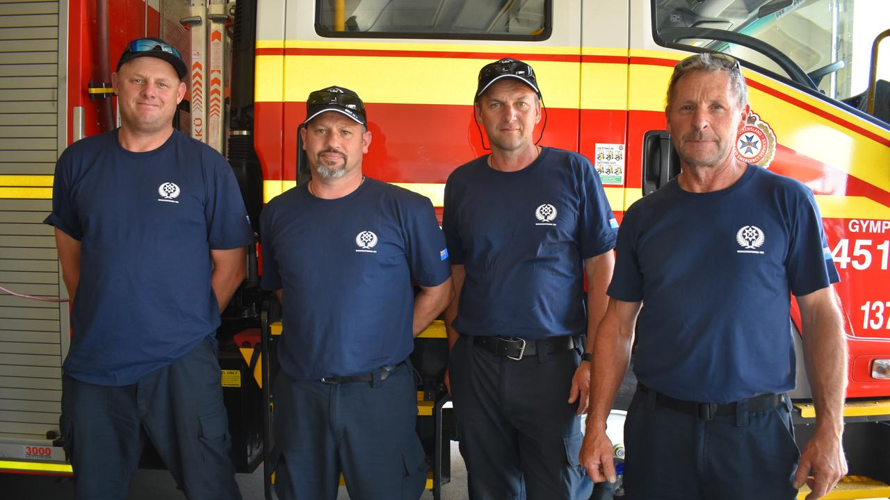 Martijn Brunner, Tim Clark, Alister Neal and Mike Donovan from the New Zealand fire and rescue helping with the current fire situation near Widgee.